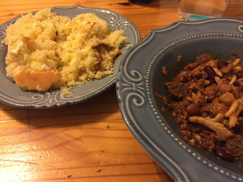 The cornbread crumbles beneath my butter, and the chili warms my stomach. A perfect pairing for a cold day.